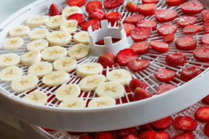 Banana slices and strawberries in dehydrator