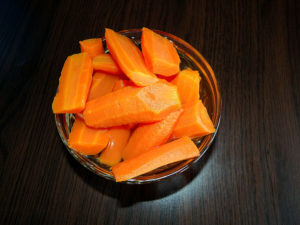 Bowl of cooked carrot pieces