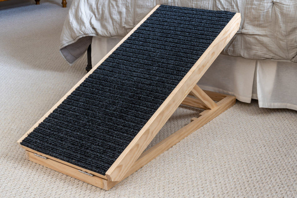 Dog ramp beside bed